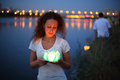 Girl are getting ready to launch a water lanterns in the river in the evening Stock Photography