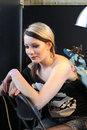 Girl getting a tattoo at a tattoo studio artist work parlor Stock Image