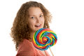 Girl with giant lollypop licks her lips Royalty Free Stock Photo