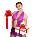 Girl with gift box and bow. Royalty Free Stock Image