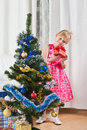 Girl with gifts near a New Year tree Royalty Free Stock Image