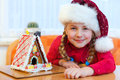 Girl with gingerbread house Stock Photos