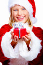 Girl giving Christmas present Royalty Free Stock Photos