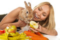 Girl giving fresh vegetables to bunny Royalty Free Stock Image