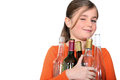 Girl with glass bottles lots of Stock Image