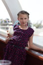 Girl with glass of milk shake on a yacht Royalty Free Stock Photos
