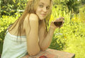 Girl with glass of red wine young happy sitting in the garden outdoor shot Stock Images