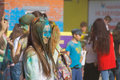 A girl with glasses and blue paint on his face the festival of colors holi in cheboksary chuvash republic russia holiday joy Royalty Free Stock Photography