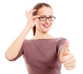 Girl with glasses showing OK sign Royalty Free Stock Images