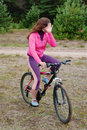 The girl goes on a bicycle Royalty Free Stock Photo