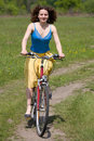 Girl goes by bicycle Royalty Free Stock Photo