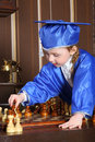Girl goes black pawn during a game of chess little Stock Image