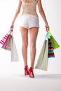 Girl goes with the shopping bags. Royalty Free Stock Photo