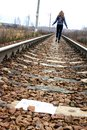 stock image of  Girl goes on the tracks thinking about life