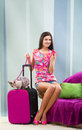 Girl going on vacation with her cat smiling pretty packed suitcase sitting the sofa a leash Stock Images