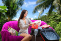 Girl going on vacation packing a suitcase and dreaming of tropical nature background Stock Images