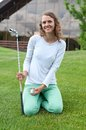 Girl golf player teeing off with driver from tee box front view Royalty Free Stock Image