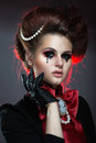 Girl in gothic art style with creative makeup drop on her face Royalty Free Stock Photo