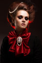 Girl in gothic art style with creative makeup. image for Halloween. Royalty Free Stock Photo