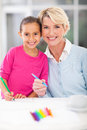 Girl grandmother drawing happy little with her at home Royalty Free Stock Photo