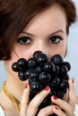 Girl with grapes Stock Image