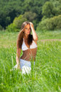 Girl in grass Royalty Free Stock Photos