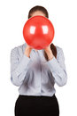 Girl in a gray shirt holds a balloon inflated Stock Images