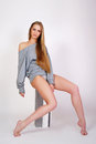 Girl in a gray volume jacket with long legs Royalty Free Stock Photo