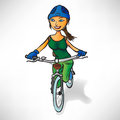 Girl in the green rides a bike Royalty Free Stock Photo