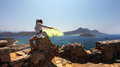 Girl with green yellow scarf a panoramic view from gramvousa crete greece over the sea and islands nearby combining crystal clear Stock Image