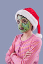 Girl with grinch like face paint. Stock Image