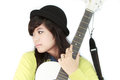 Girl with guitar a asian white acoustic Stock Photo