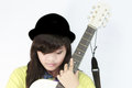 Girl with guitar a asian white acoustic Stock Photography