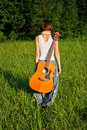 Girl with guitar outdoors Stock Image