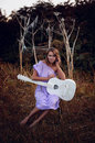 Girl with guitar sad muse a broken Stock Image