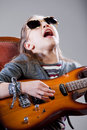 Girl with guitar and sunglasses Royalty Free Stock Photo