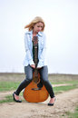 The girl with a guitar young beautiful acoustic posing outside Royalty Free Stock Photo