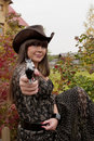 Girl with the gun in western style Royalty Free Stock Photography