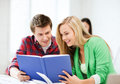 Girl and guy reading book at school Royalty Free Stock Photo