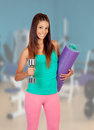 Girl at the gym ready for sports young beautiful woman Stock Photos