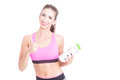 Girl at gym showing thumb up holding water bottles isolated on white background with copy text space Royalty Free Stock Photos
