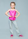Girl gymnast cute smiling little in studio Royalty Free Stock Photography
