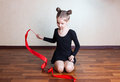 stock image of  Girl gymnast with red ribbon