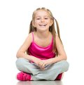 Girl gymnast smiling little in studio over white background Royalty Free Stock Image