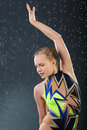 Girl gymnast took graceful pose in rain Stock Photo