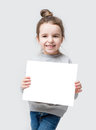 Girl with hair beam holding a white paper you can place your text isolated on gray background Royalty Free Stock Photography