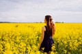 Girl with hand in hair on rapeseed meadow Royalty Free Stock Photo