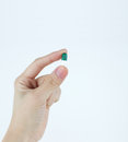 Girl hand hold pill Royalty Free Stock Photography