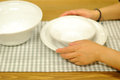 Girl hand holding plates on table Royalty Free Stock Photos