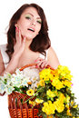Girl with hand nea face and basket spring flower. Stock Photos